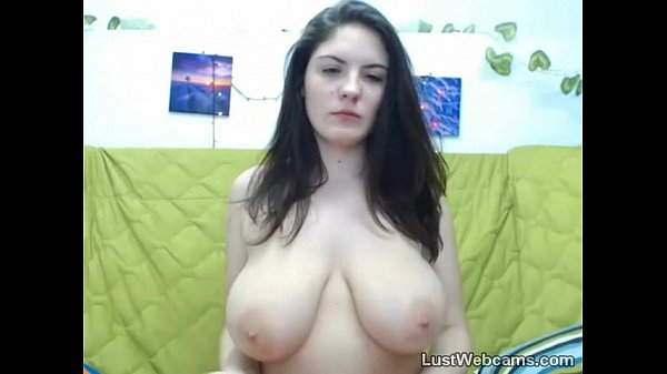 Naughty camgirl teases with her big tits